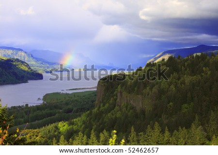 Rainbow & clouds in the Columbia River Gorge Oregon. - stock photo