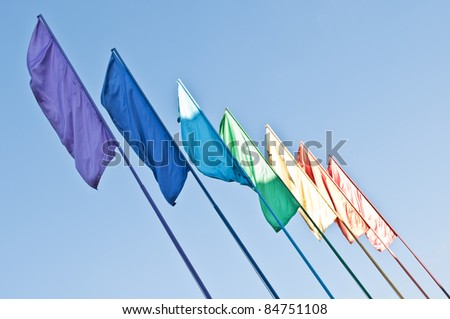 rainbow colored flags on blue sky background