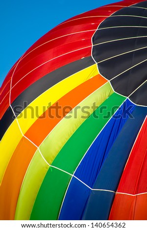 Rainbow Colored Hot Air Balloon - stock photo