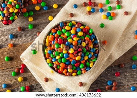 Rainbow Colorful Candy Coated Chocolate Pieces in a Bowl - stock photo