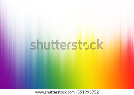 Rainbow colors with white rays of light blend to create abstract background
