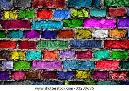 Rainbow colourful brick wall (background) - stock photo