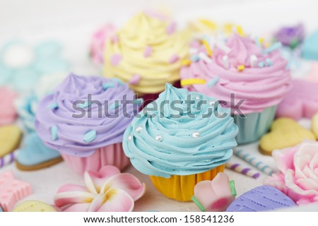 Rainbow cupcakes with sprinkles and decoration