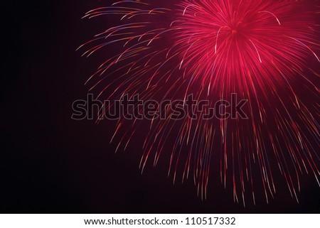 rainbow firework on night sky - stock photo