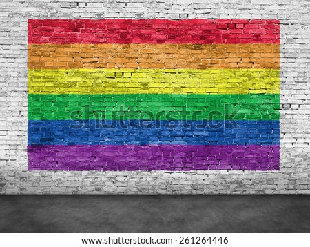 Rainbow flag painted over old white brick wall - stock photo