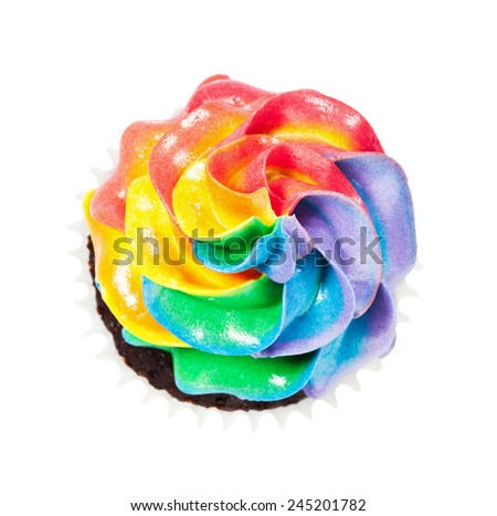 Rainbow Icing Cupcake - stock photo