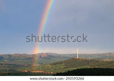 Rainbow in a rural landscape - stock photo