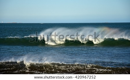 rainbow in a wave at newport, rhode island - stock photo