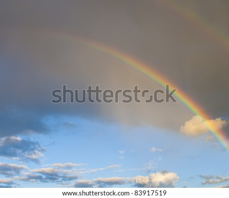 Rainbow in front of dark cloud