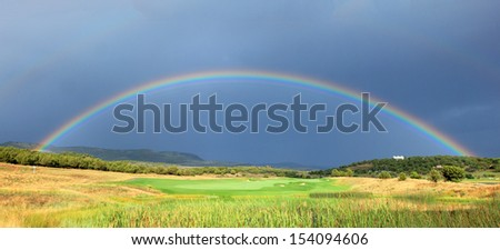 Rainbow in Heber Valley, Utah, USA. - stock photo