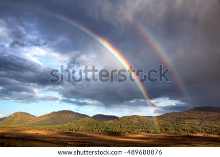 Rainbow in in Yazevoe valley, Altai mountains, Kazakhstan, Central Asia