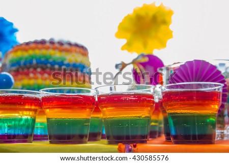 Rainbow jelly on party birthday table - stock photo