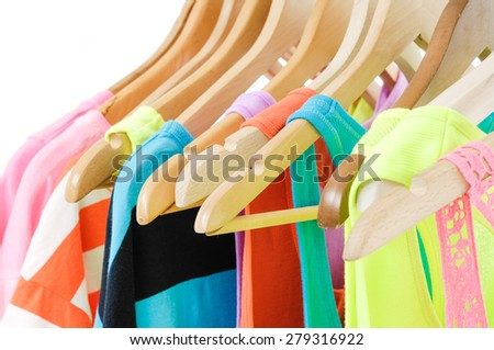 rainbow many peignoir hanging on hangers - stock photo