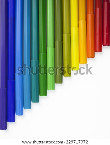 Rainbow marker pens isolated on a white background - stock photo