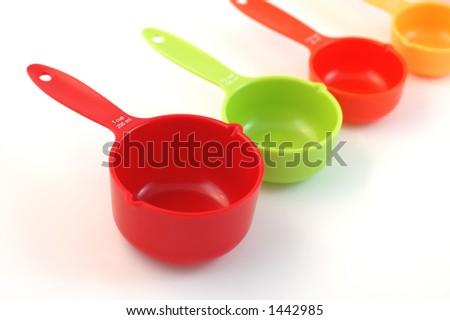 Rainbow measurement cups - stock photo