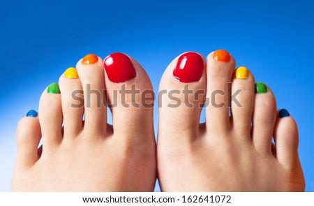 Rainbow nail polish feet art - stock photo