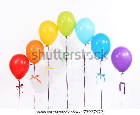 Rainbow of balloons isolated on white