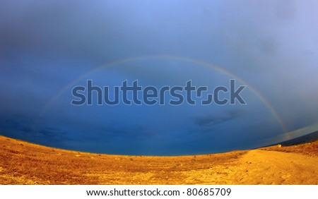 Rainbow on the Black sea coast at sunset.