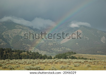 Rainbow on the mountains - stock photo
