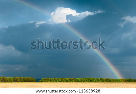 Rainbow. On the photos are visible traces of heavy rain
