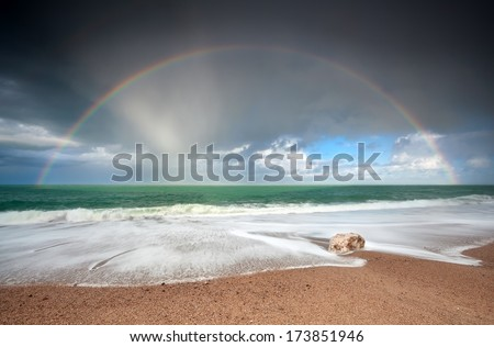 rainbow over Atlantic ocean waves on coast, Etretat, France - stock photo