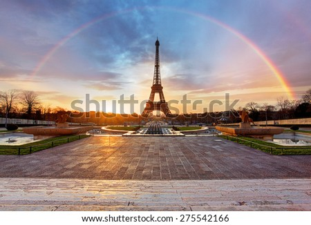 Rainbow over Eiffel tower, Paris - stock photo