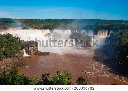 Rainbow over gorgeous waterfalls of Iguazu, Brazil. - stock photo