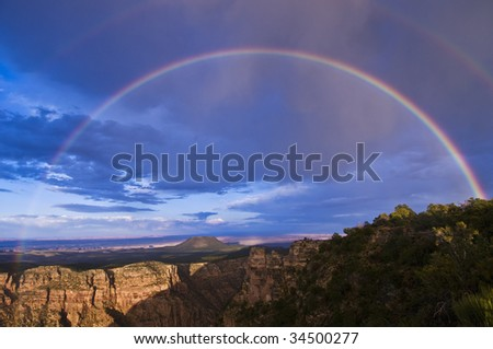 Rainbow over Grand Canyon - stock photo