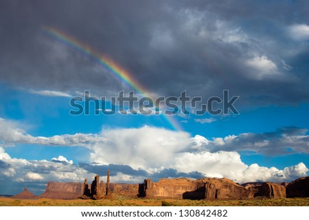 Rainbow over Monument Valley after the storm - stock photo