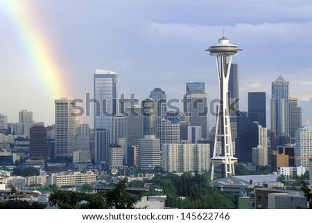 Rainbow over Seattle, WA skyline with Space Needle - stock photo