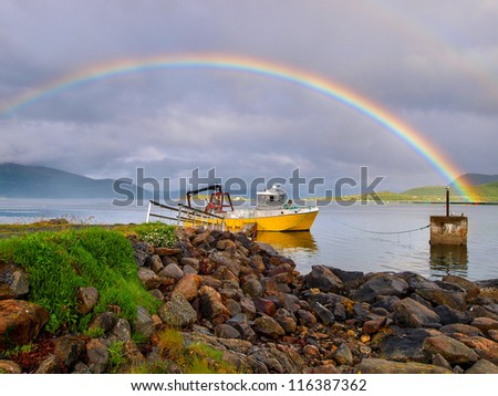 rainbow over ship - norway - stock photo