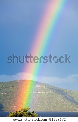 Rainbow over the Adriatic sea - stock photo