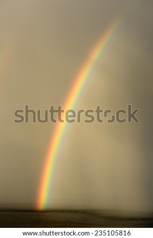 Rainbow over the Atlantic Ocean - stock photo