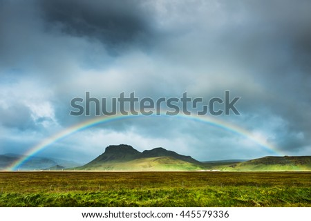 Rainbow over the mountains, South Iceland. Beautiful summer landscape