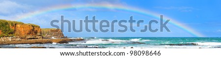 Rainbow over the sea. Panorama - stock photo