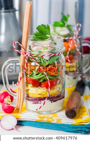 Rainbow Picnic Chicken and Vegetable Salad in a Mason Jar, copy space for your text - stock photo