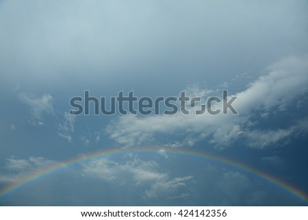 rainbow sky after the storm - stock photo