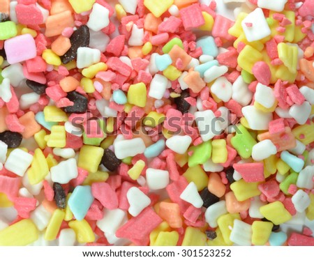 Rainbow Sprinkles Confectionery Topping Background - stock photo