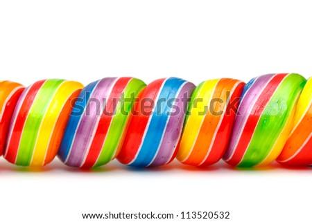 Rainbow Twirl Lollipop Candies, closeup - stock photo