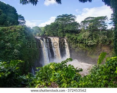 Rainbow (Waianuenue) Falls is a waterfall located in Hilo, Hawaii. - stock photo