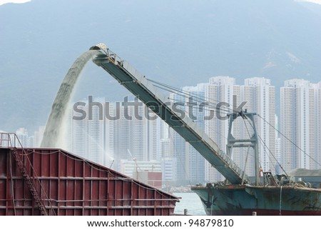 Rainbowing / unloading sand Barge - stock photo