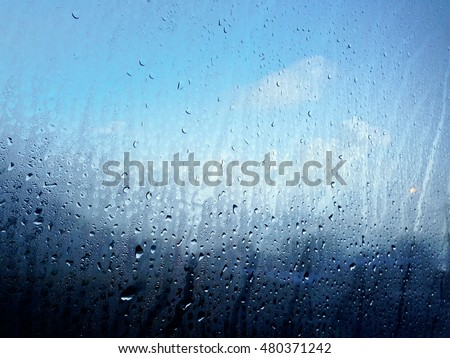 Raindrop on window glass