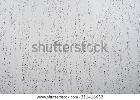 raindrops in a window, white abstract background - stock photo