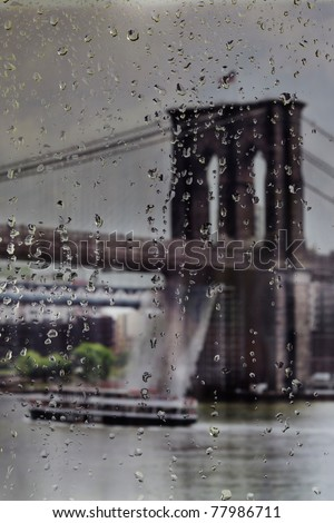 Raindrops on a window looking over the Brooklyn Bridge