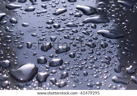 Raindrops on metal surface - stock photo