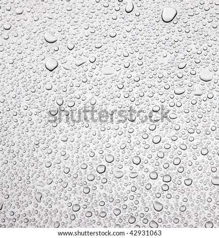 Raindrops on metallic surface (web use quality) - stock photo