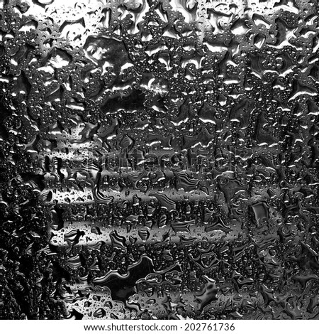 Raindrops on mirror (ideal for unique abstract wallpapers).in square - stock photo