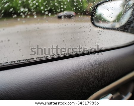 Raindrops on the glass of the car, the driver's door