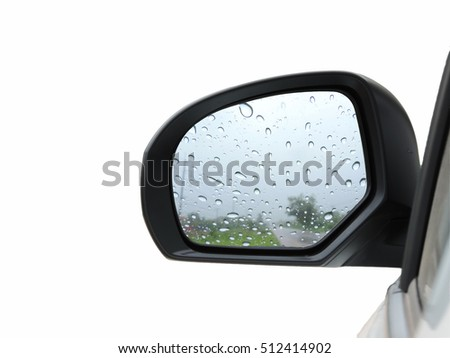 Raindrops on the rear-view mirror.
