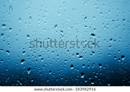 Raindrops on the window glass. In front of out of focus background.